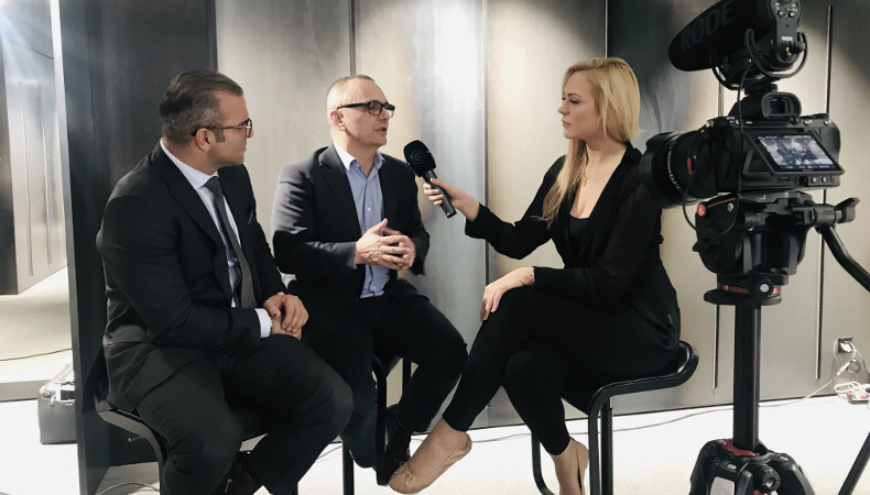 CEO Arman Sarhaddar and COO Urs E. Gattiker with Jessica Walker talking about the iVAULT Blockchain on TV